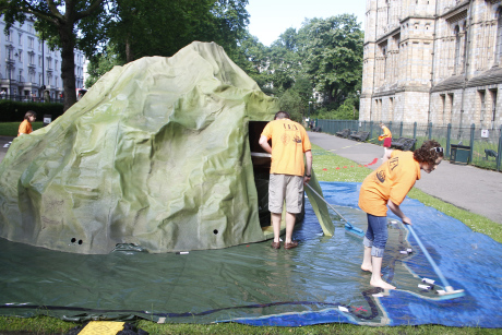 Preparing the volcano after overnight rain on Monday. Jon and Holly with brooms; Jennni and Emilly measuring the safety zone for the bin bang